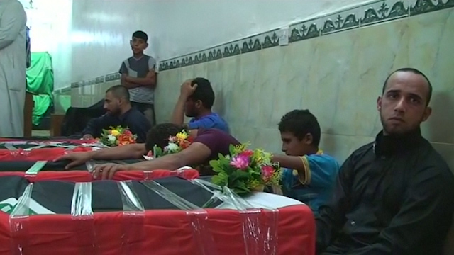 Shi'ites Mourn Relatives Killed in Market Attack South of Baghdad