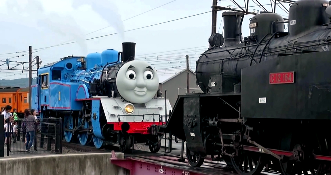 Thomas the Tank Engine tows another steam train during a test watched by the public
