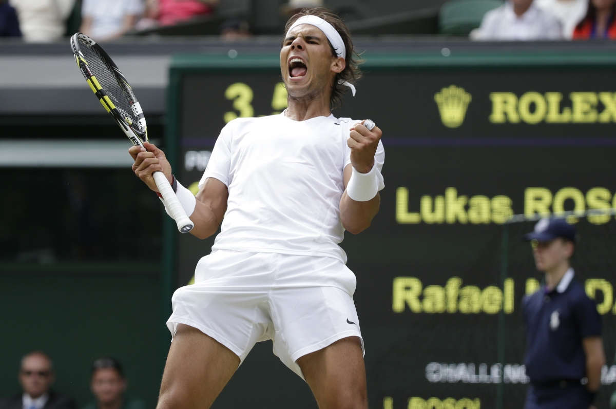 Rafael Nadal of Spain reacts after defeating Lukas Rosol of the Czech Republic
