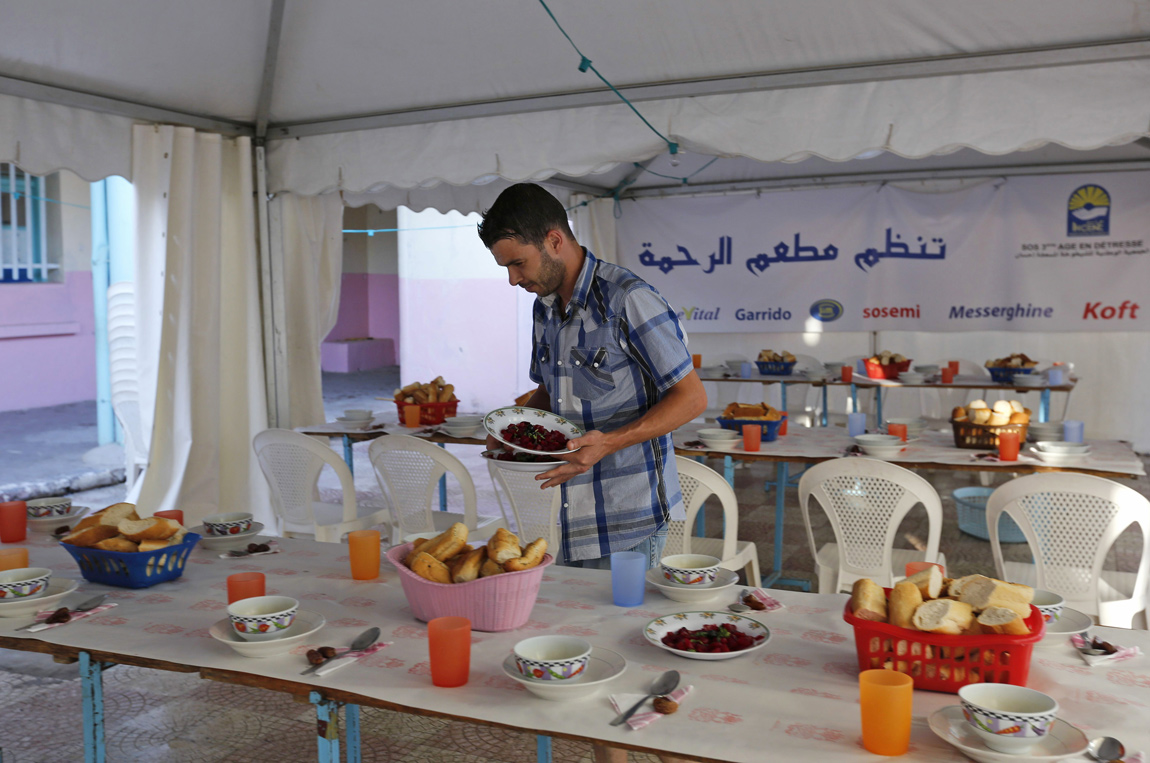 Volunteers at a charity prepare food for Iftar in Algeria