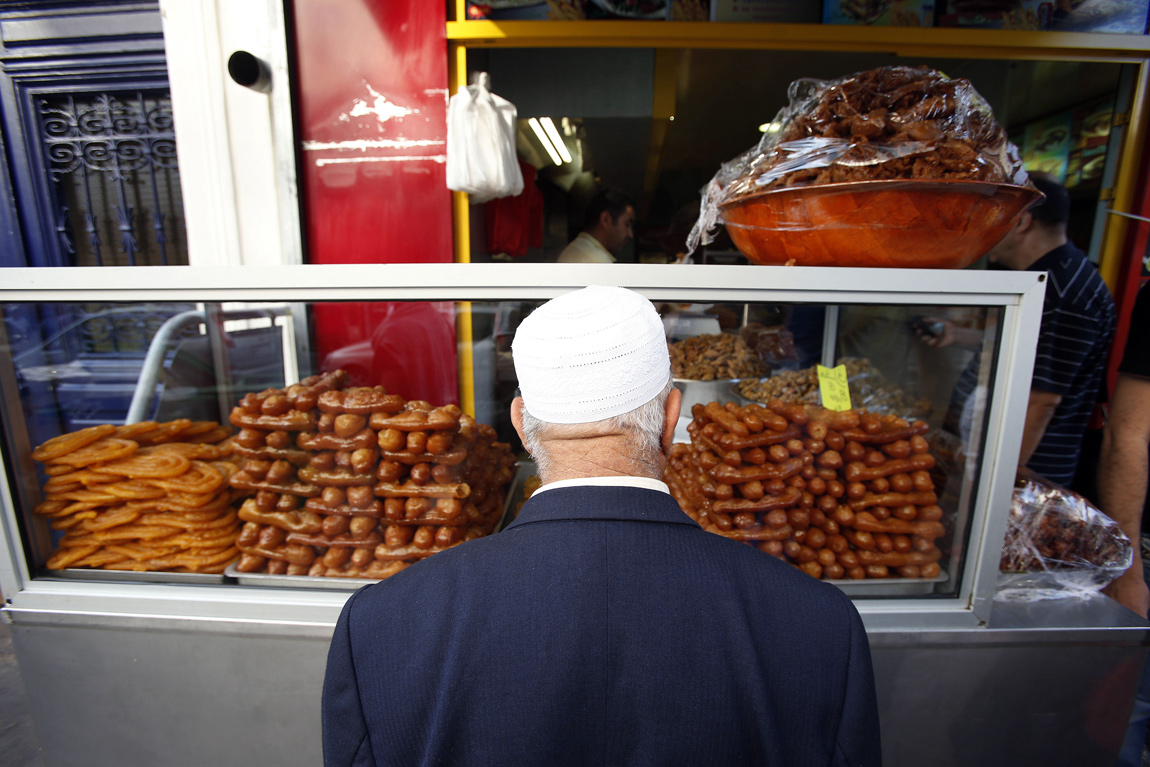 A man shops for traditional sweets during Iftar in Paris