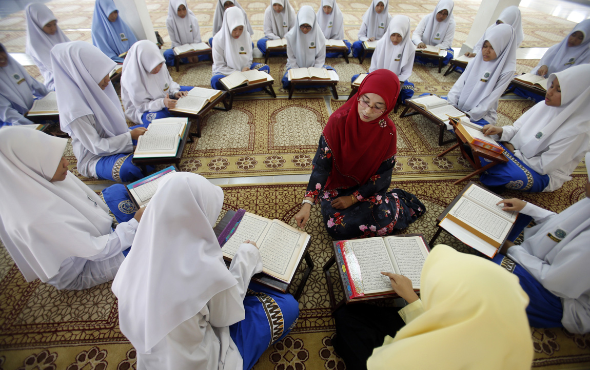 Muslim schoolgirls recite verses from the Quran on the occasion of
