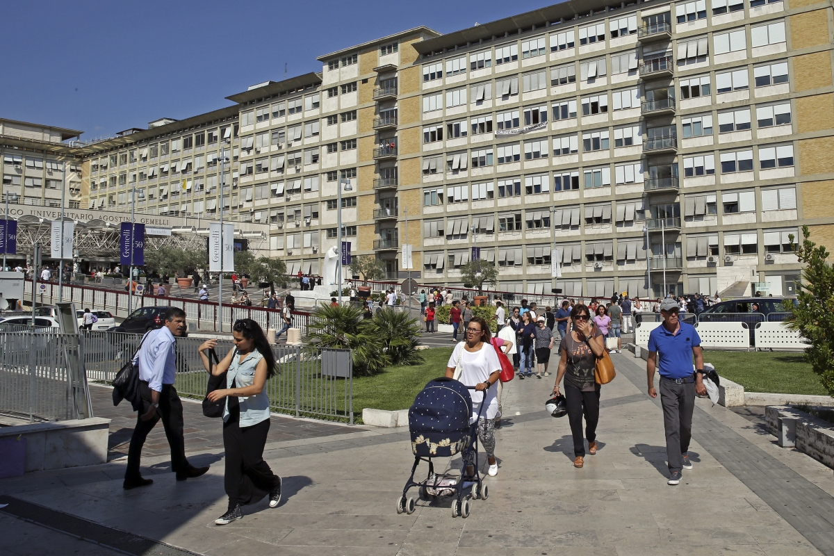 People leave Gemelli hospital after Pope Francis cancelled his visit in Rome