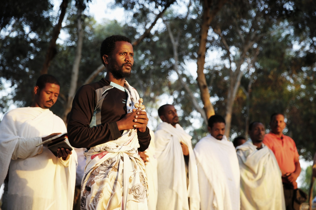 African asylum seekers pray at sunrise after leaving Holot open detention centre and camping out over night in southern Israel's Negev desert,