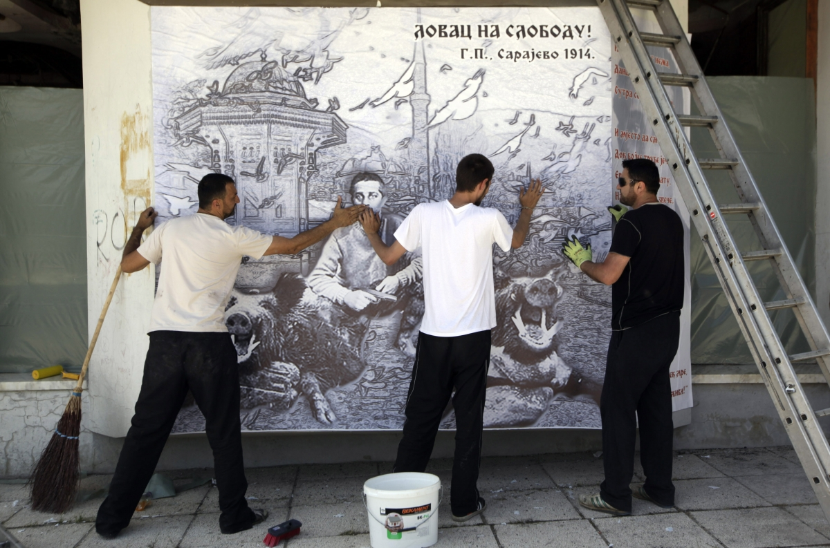 People put up a poster of Gavrilo Princip, the 19-year-old Bosnian Serb who gunned down Archduke Franz Ferdinand in 1914 and lit the fuse for World War One, in Bosansko Grahovo, next to Princip's birth village in Obljaj