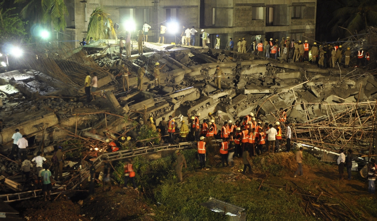 Rescue workers conduct a search operation for survivors at the site of a collapsed 11-storey building that was under construction on the outskirts of the southern Indian city of Chennai June 28, 2014.