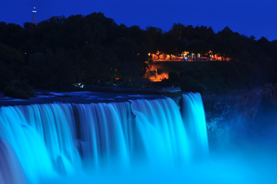 3. Blue light illuminates the falls in Niagara Falls