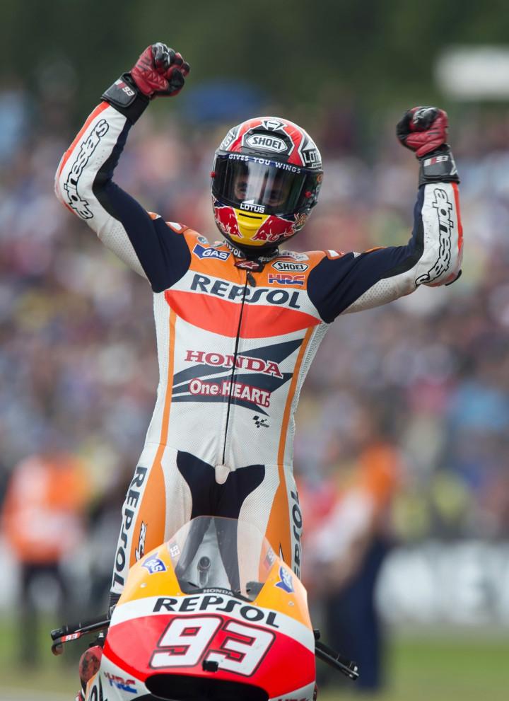 Honda MotoGP rider Marc Marquez of Spain celebrates after winning the Dutch Grand Prix in Assen June 28, 2014