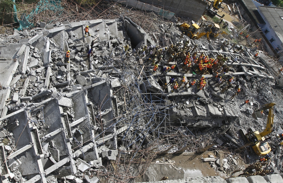 Rescue workers conduct a search operation for survivors at the site of a collapsed 11-storey building that was under construction on the outskirts of the southern Indian city of Chennai.