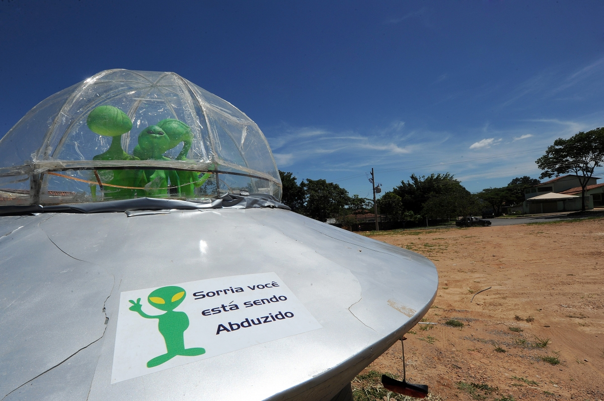 A mock UFO with alien dolls and reading 'Smile, you are being abducted' is seen in Alto Paraiso town, Goias State