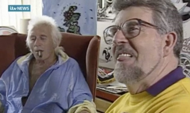 Child sex abuser Rolf Harris licks his lips while enjoying time with fellow paedophile Jimmy Savile