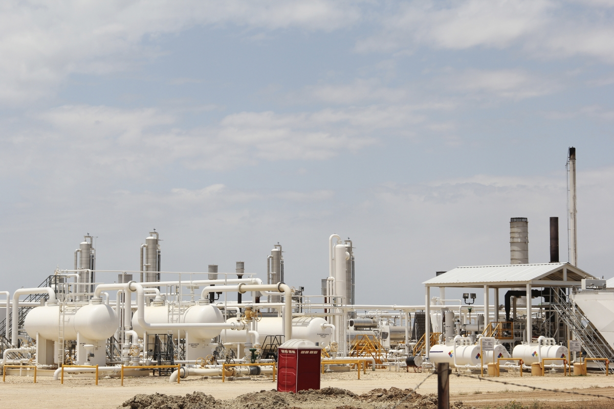 An oil and gas processing plant fed by local shale wells is pictured along a highway outside Carrizo Springs, Texas