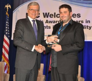 Ian Hamilton Accepting Award from FCC