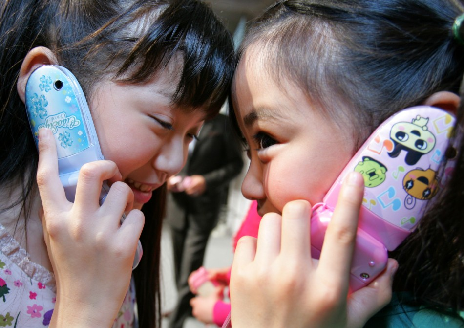 Children talking on their cell phones