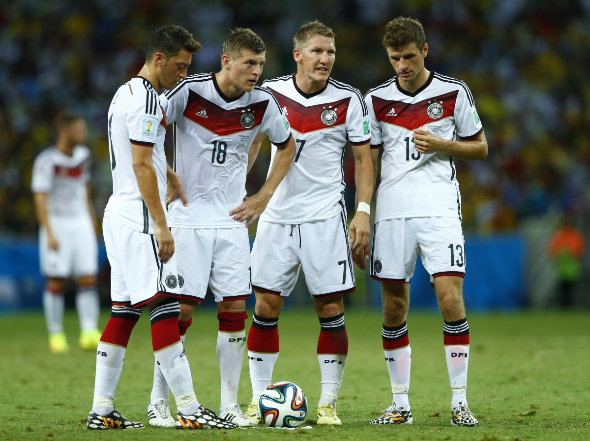Germany's Mesut Ozil, Toni Kroos, Bastian Schweinsteiger and Thomas Mueller