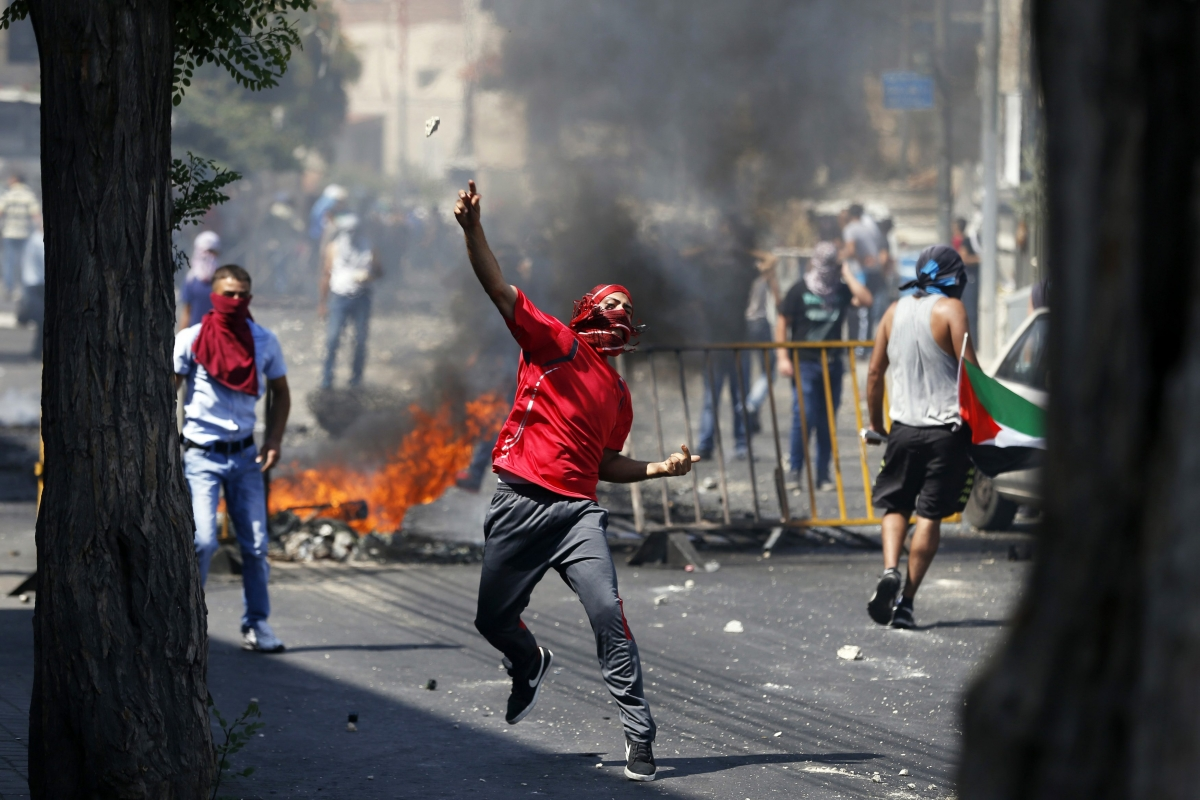 Palestinians clash with Israeli police in response to Mohammed Abu Khudair's killing.