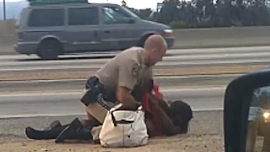 LA Police officer punches woman