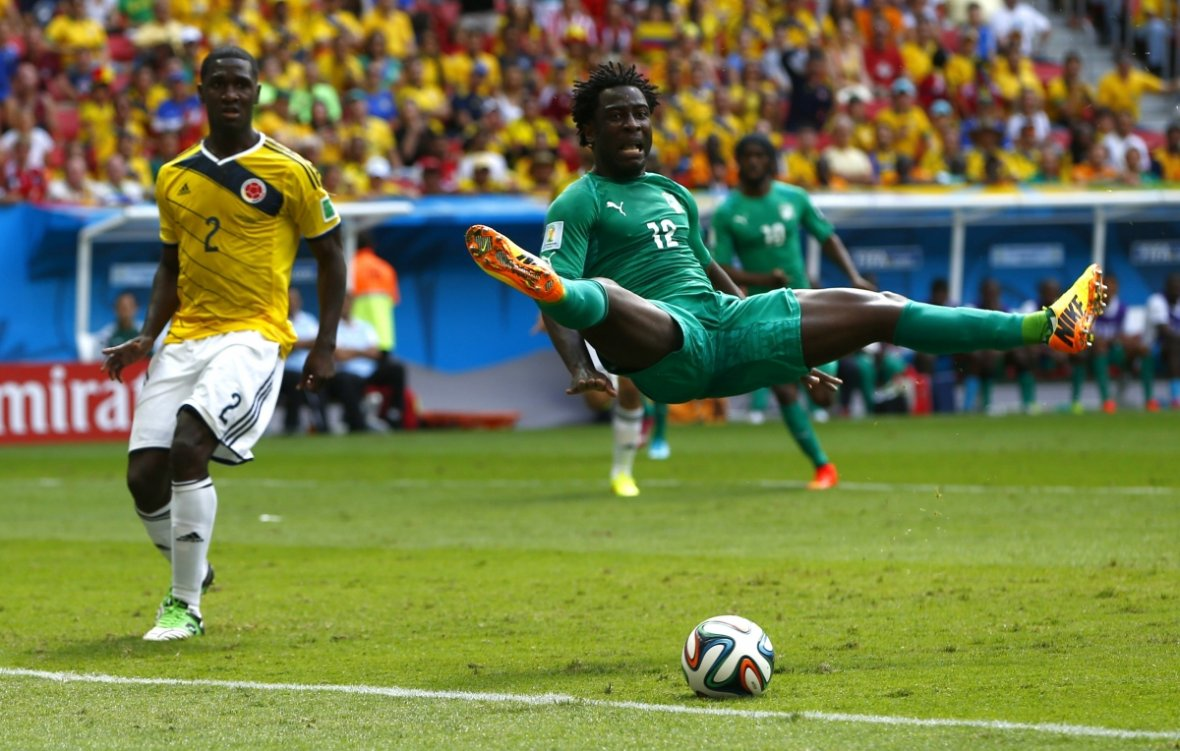 This pose isn't at all painful. Colombia's Cristian Zapata watches on in disbelief as Ivory Coast's Wilfried Bony jump during their 2014 World Cup Group C soccer match