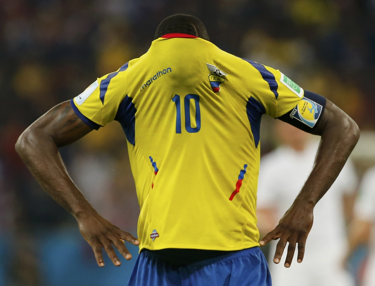 Ecuador's Walter Ayovi covers his face with his jersey after their 2014 World Cup Group E soccer match against France