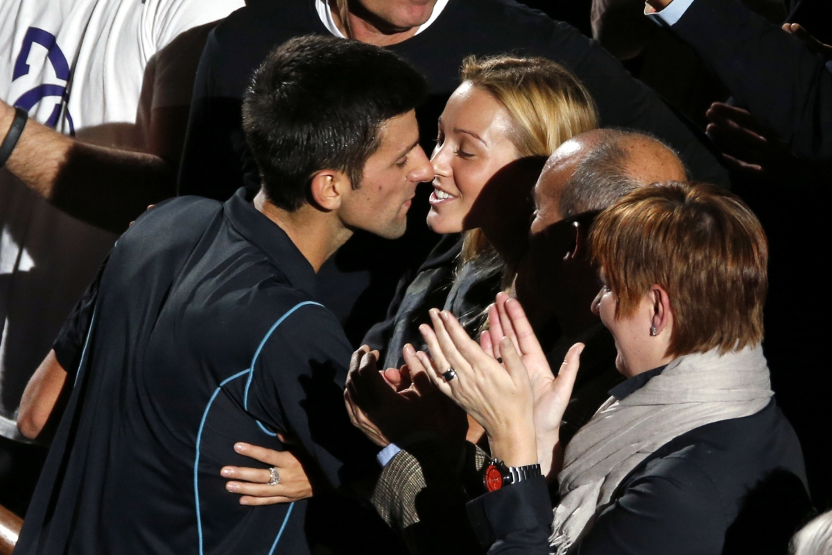 Novak Djokovic of Serbia (L) kisses his fiancee Jelena Ristic (C) after he defeated David Ferrer of Spain in their final match at the Paris Masters men's singles tennis tournament at the Palais Omnisports of Bercy in Paris,