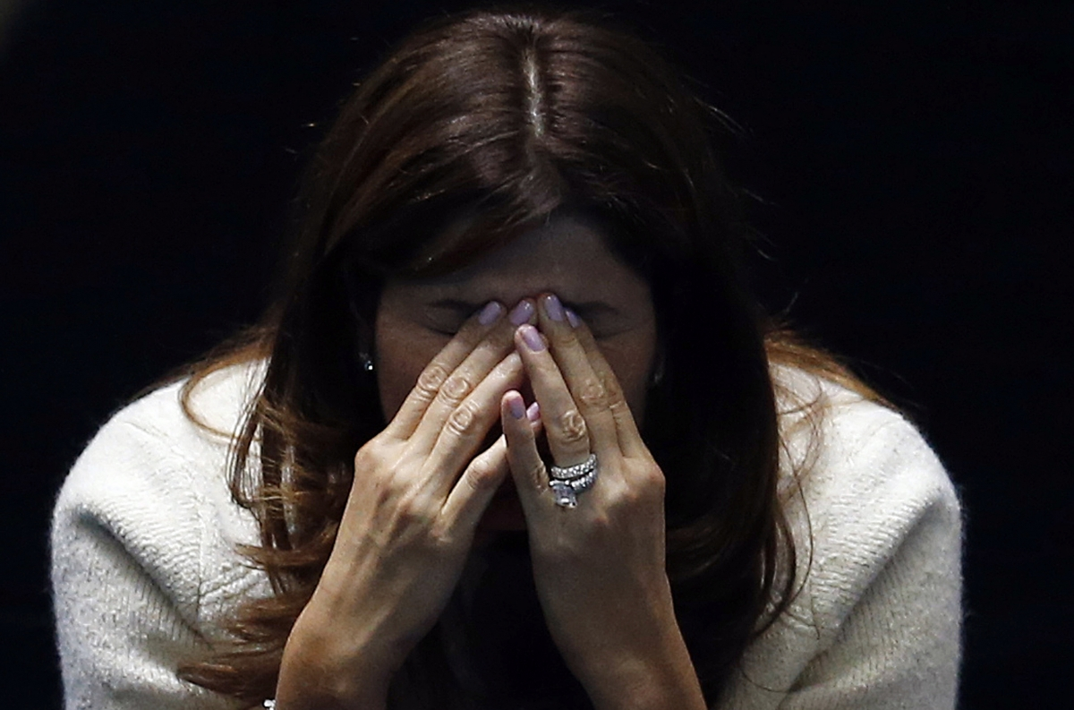 The pressure's too much for Mirka, as her husband competes against Novak Djokovic of Serbia at the ATP World Tour Finals at the O2 Arena in London