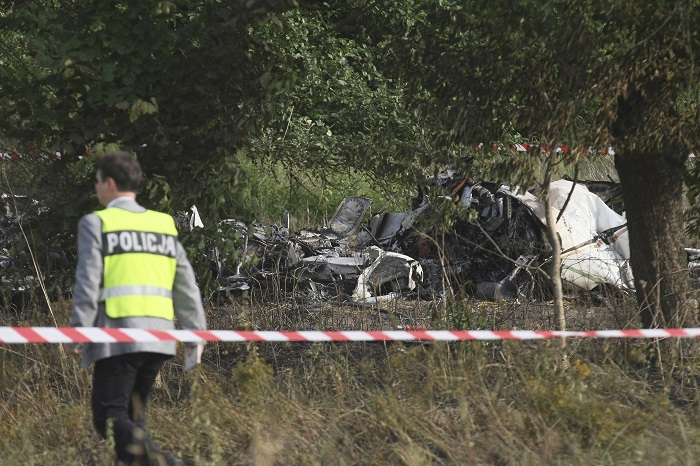 A policeman inspects the site of the crash of the Piper PA-31 Navajo plane in Topolow near Czestochowa.