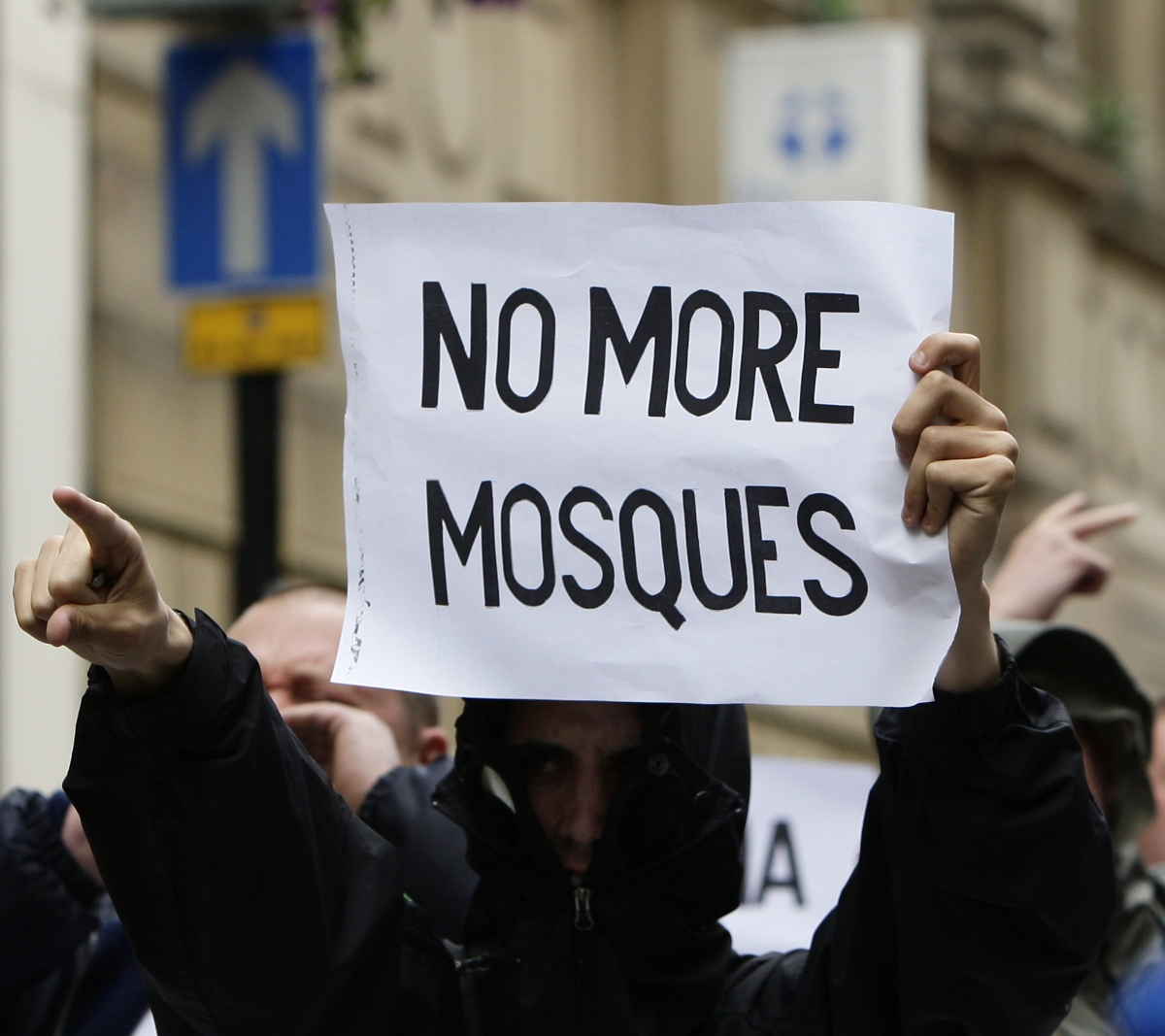 An EDL supporter holds up an anti-Islam message during a rally in Birmingham. (Reuters)
