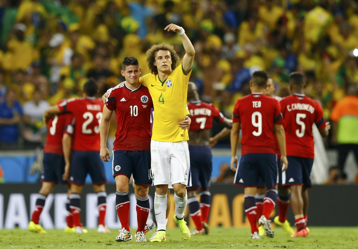 Brazil's David Luiz gestures at Colombia's James Rodriguez as he tells the spectators to applaud him after their 2014 World Cup quarter-finals at the Castelao arena in Fortaleza