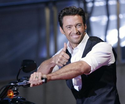 Actor Hugh Jackman gestures to fans during the Japan premiere of quotX-men OriginsWolverinequot in Tokyo.