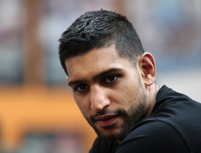 Amir Khan was arrested over an alleged assault on two men in his hometown of Bolton