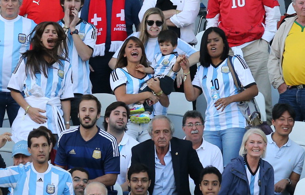 Antonella Roccuzzo, girlfriend of Lionel Messi and their son, Thiago Messi attend the 2014 FIFA World Cup Brazil Round of 16 match between Argentina and Switzerland at Arena de Sao Paulo on July 1, 2014 in Sao Paulo, Brazil