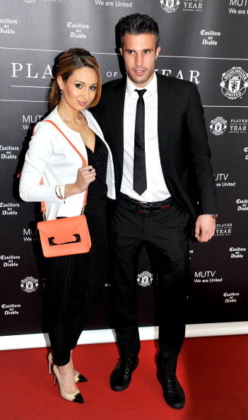 Robin Van Persie and Bouchra Van Persie attend the Manchester United Player of the Year awards at Old Trafford on May 8, 2014 in Manchester.