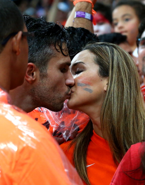 Robin van Persie of the Netherlands kisses his wife Bouchra after the win in the 2014 FIFA World Cup Brazil Quarter Final match between Netherlands and Costa Rica at Arena Fonte Nova on July 5, 2014 in Salvador, Brazil