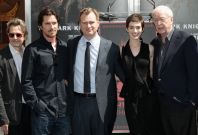 Director Christopher Nolan (C) poses with actors (from L-R) Gary Oldman, Christian Bale, Anne Hathaway and Michael Caine
