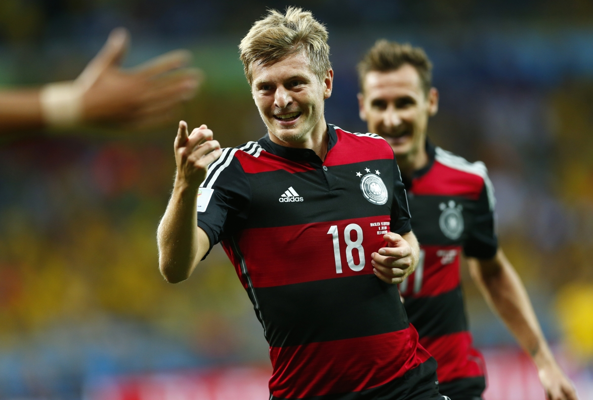 Germany\'s Toni Kroos celebrates after scoring his second goal during the 2014 World Cup semi-finals against Brazil