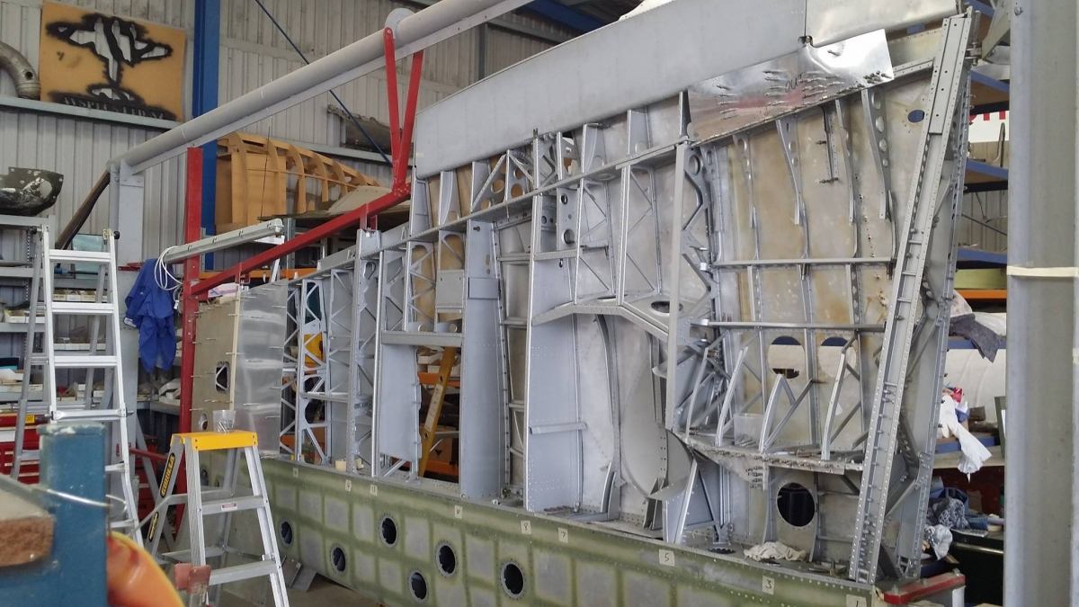 The wing-frame of a Spitfire XVI, TB252 plane being repaired at the workshop