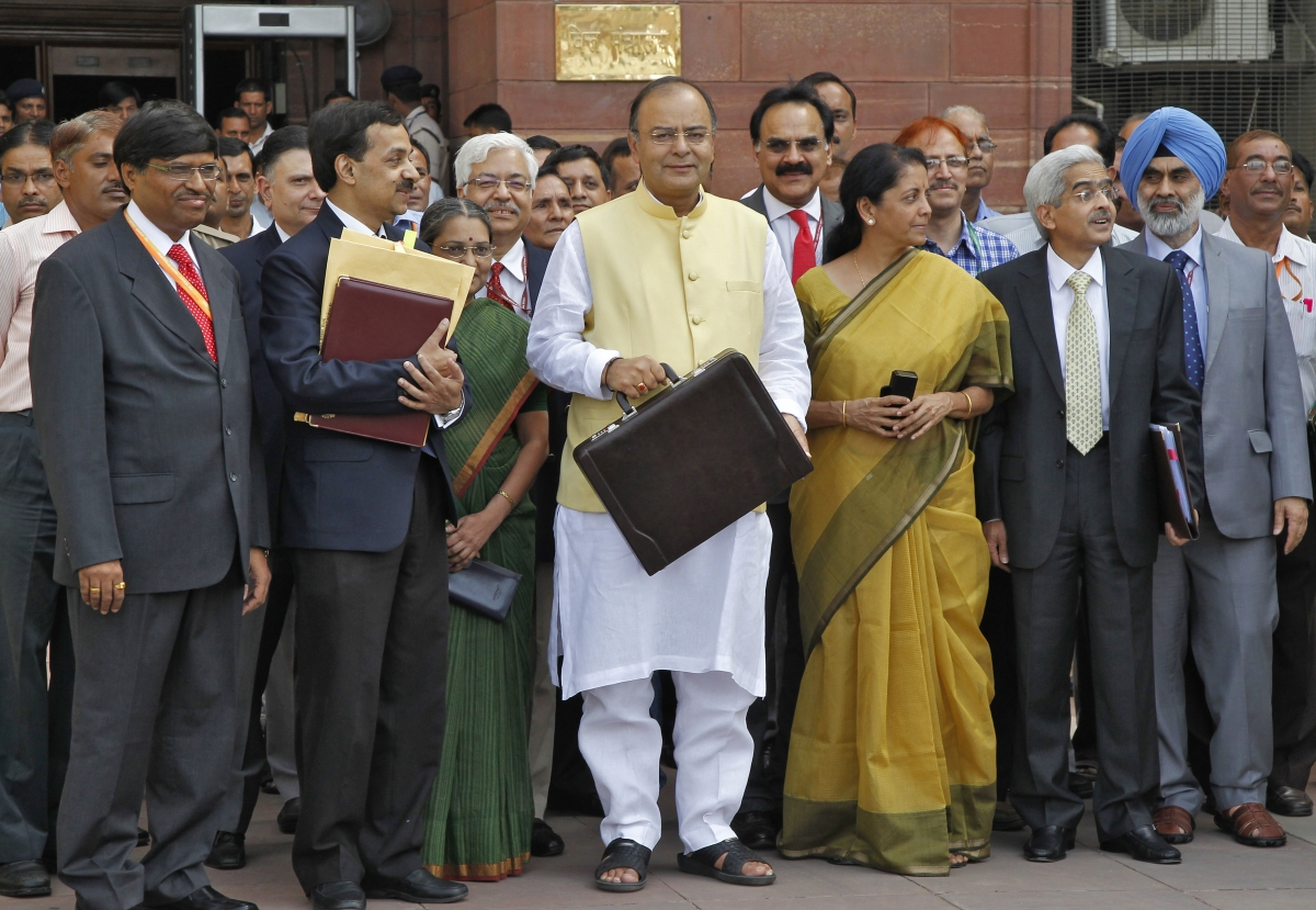 India's Finance Minister Arun Jaitley (C) poses as he leaves his office to present the federal budget for the 2014/15 fiscal year, in New Delhi