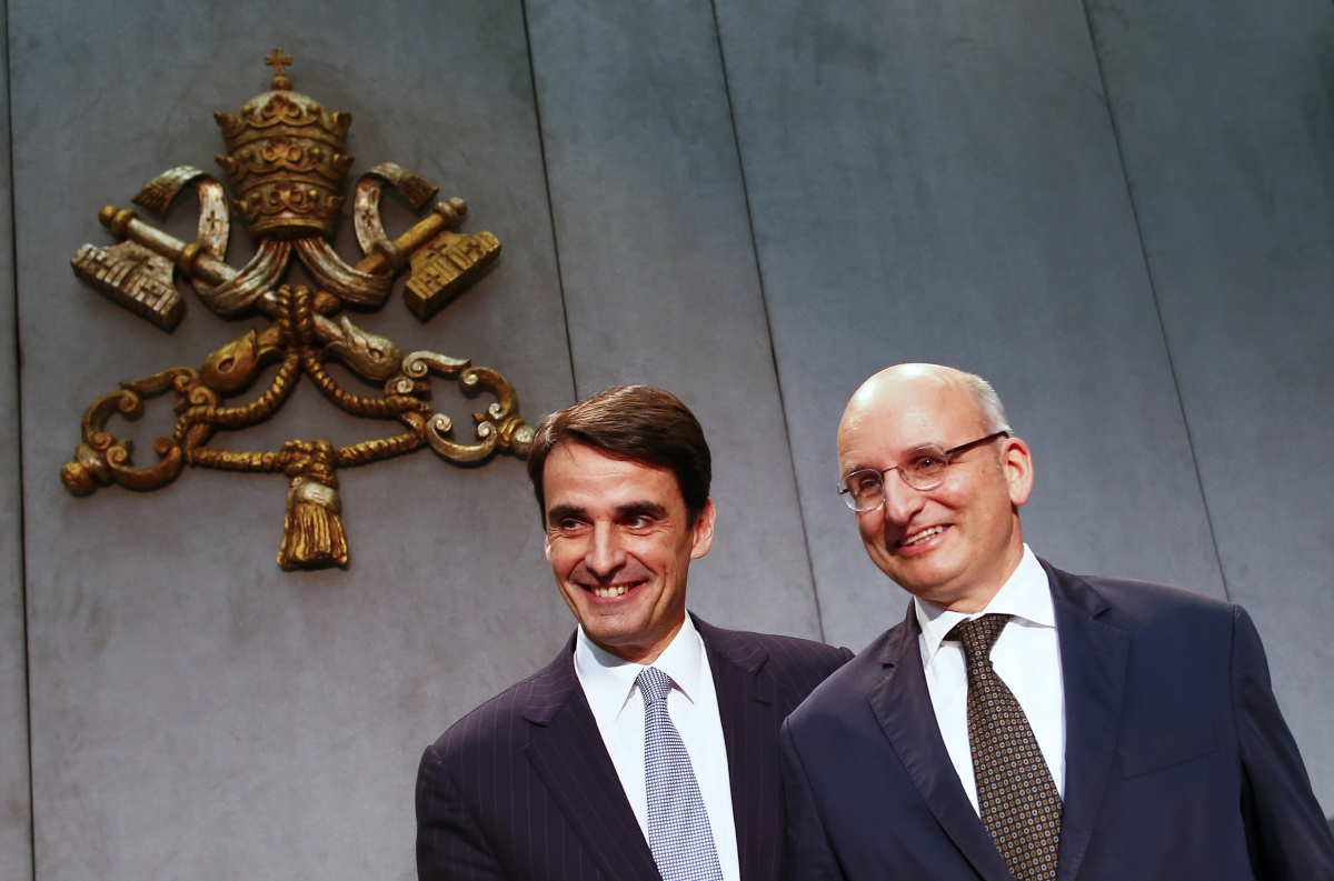 Jean-Baptise de Franssu (L), new president of Vatican Bank IOR, and outgoing President Ernst Von Freyberg pose during a news conference at the Vatican July 9, 2014