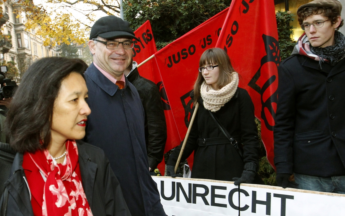 Members of the youth organisation of the Swiss Social Democratic Party welcome former Swiss private banker Rudolf Elmer. The word on the banner reads,