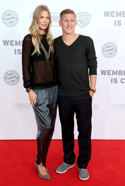 German football player Bastian Schweinsteiger (R) and his girlfriend Sarah Brandner