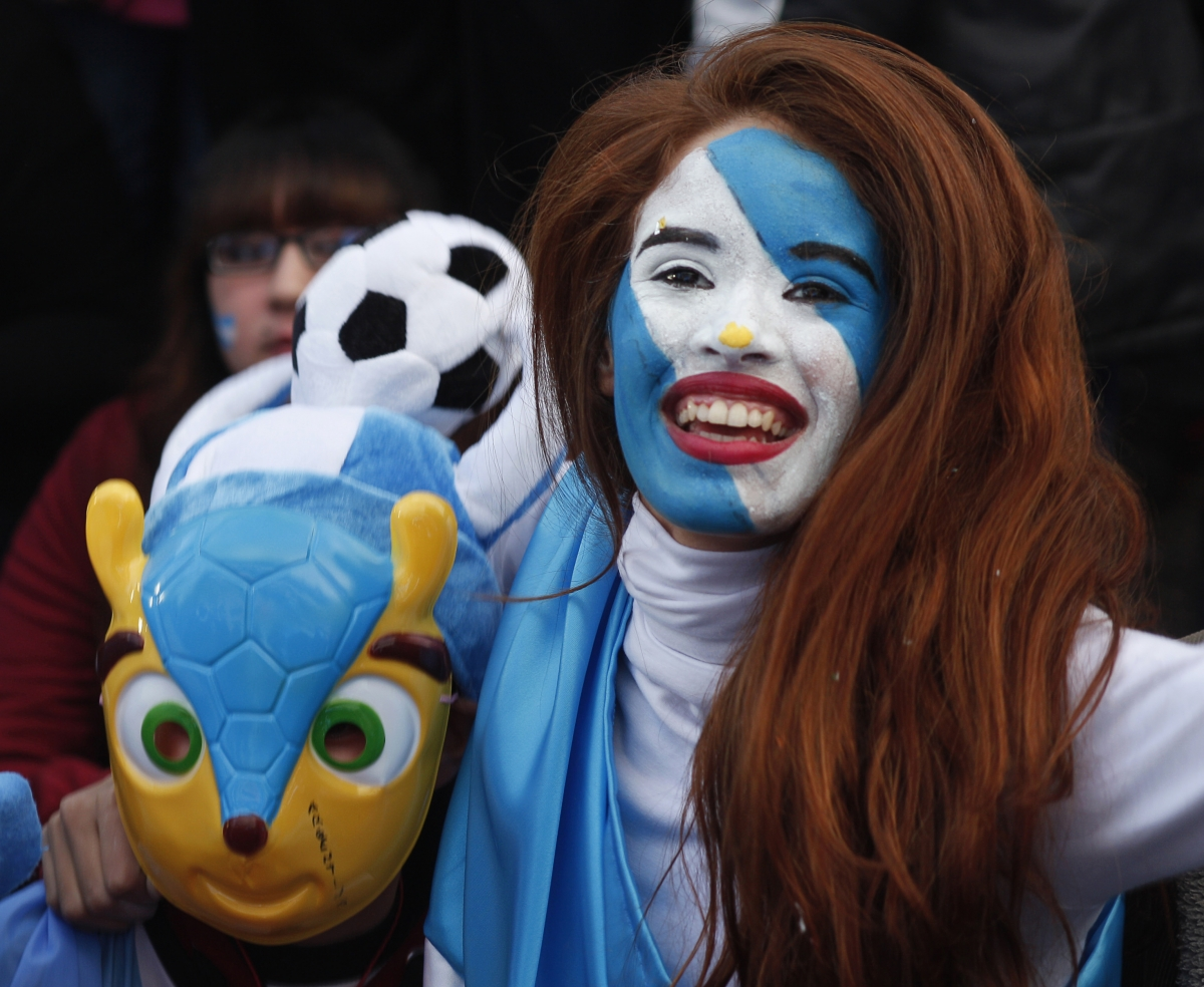 An Argentine fan celebrates at the end of the 2014 World Cup semi-final soccer match against the Netherlands