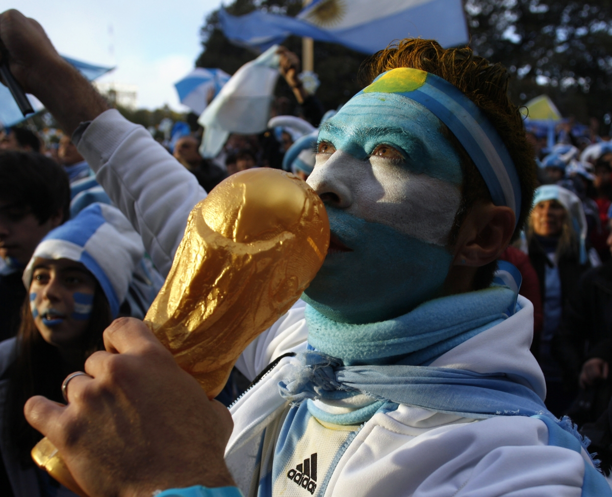 An Argentine fan holds a replica of the World Cup trophy in anticipation of a victory over Germany