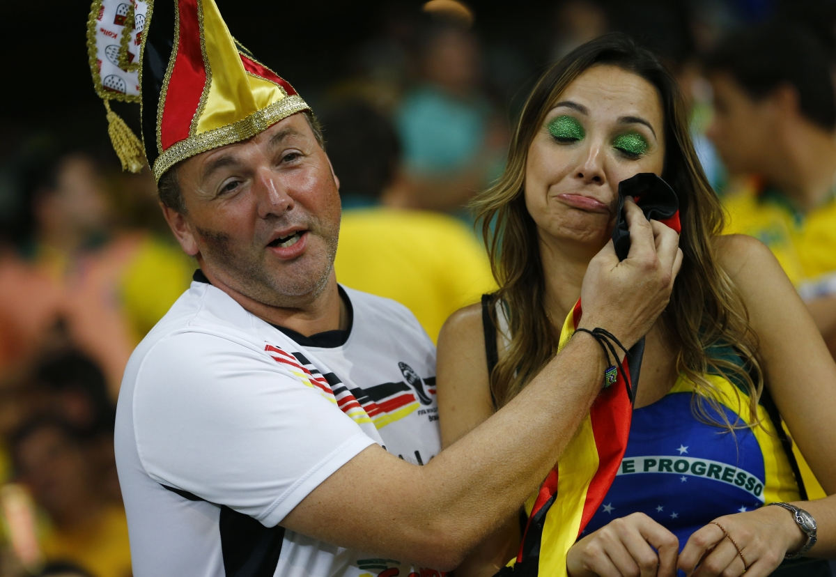 Who says chivalry is dead? A Germany fan consoles a Brazil supporter