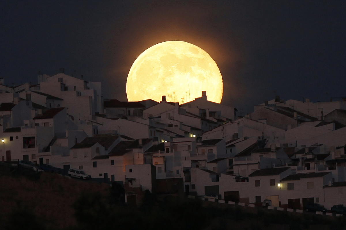 The Supermoon rises over houses in Olvera, in the southern Spanish province of Cadiz