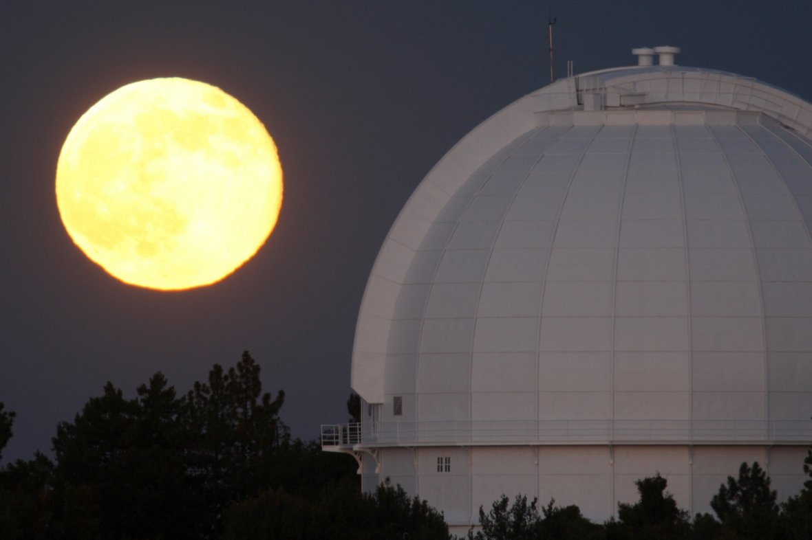 The supermoon, or perigee moon, rises behind the Mount Wilson Observatory at Mount Wilson in the Angeles National Forest