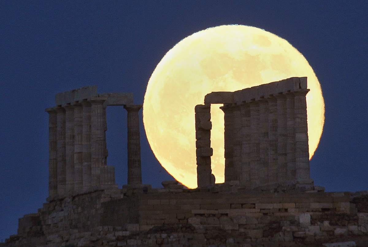 A supermoon rises over the temple of Poseidon, the ancient Greek god of the seas, in Cape Sounion, Greece