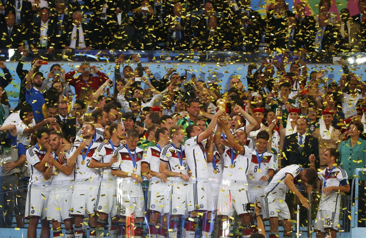 Germany's players lift the World Cup trophy as they celebrate their 2014 World Cup final win against Argentina at the Maracana stadium in Rio de Janeiro July 13, 2014.
