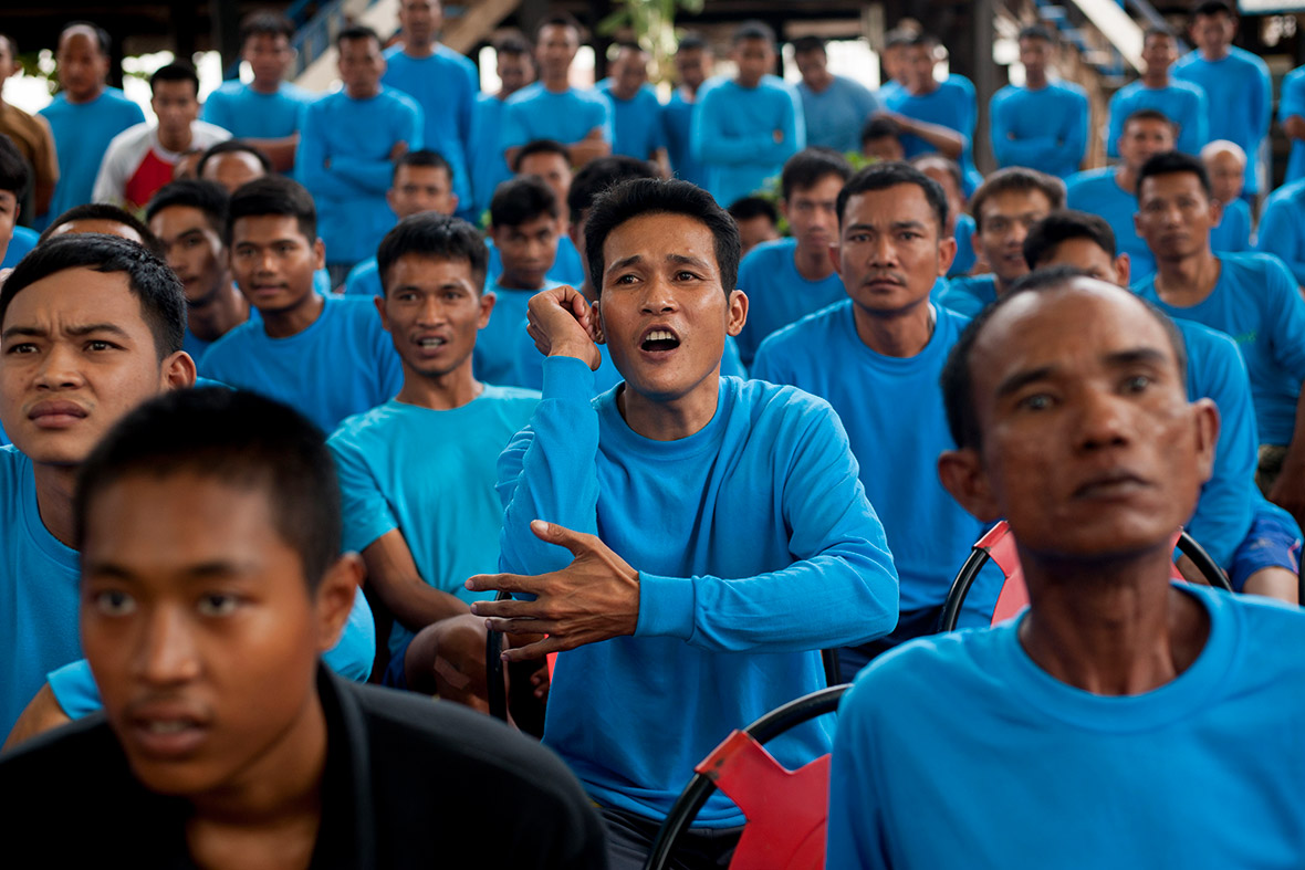 Inmates react during a Muay Thai fight at Klong Pai prison