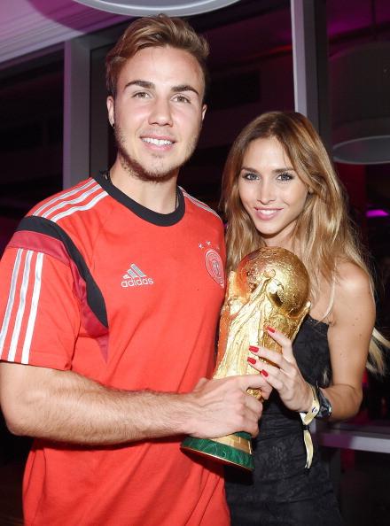 Goalscorer Mario Gotze of Germany and girlfriend Ann-Kathrin Brommel