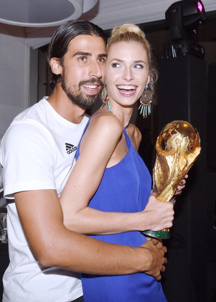 Sami Khedira of Germany and girlfriend Lena Gercke